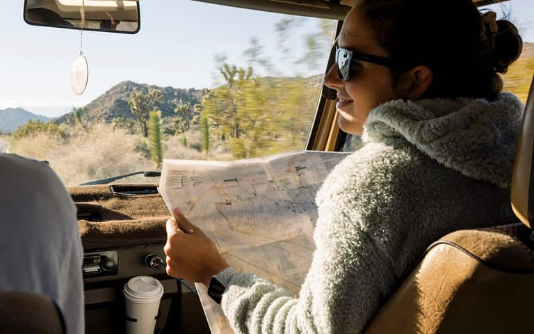Girl with map in Car