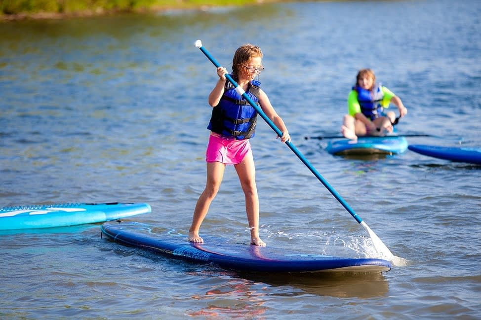 Kids on stand up paddleboard