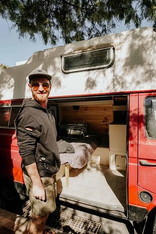 Man outside campervan