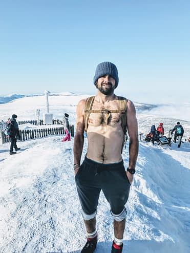 man without shirt in snow